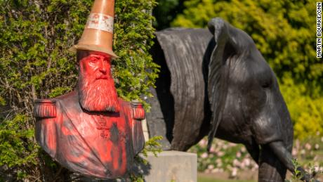 "A statue in the grounds of Belgium's Royal Museum for Central Africa, featuring a bust of KIng Leopold II, has been covered in red paint and topped with a traffic cone ""dunce's cap."""