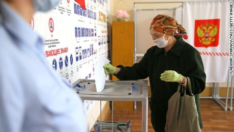 A woman casts her vote in the 2020 Russian constitutional referendum at a polling station in Amur Oblast in Russia's east.