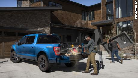 The tailgate of the new F-150 is designed to be used as a workbench. In the hybrid version of the truck tools can be plugged into outlets in the bed.