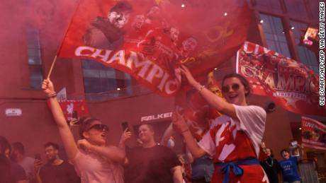 Fans celebrate outside Anfield.