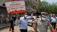 Police detaining an Indian trader who was burning Chinese products during a protest in New Delhi on Monday.