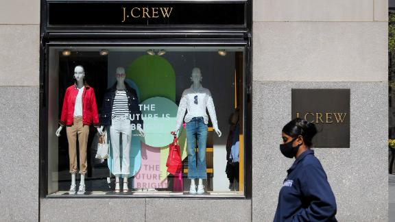 A pedestrian walks past a J.Crew store in Manhattan of New York, the United States, May 4, 2020. J. Crew Group, a U.S. apparel retailer which also operates the Madewell brand, has filed for bankruptcy protection, as the COVID-19 fallout continues to ripple through the nation. It has filed to begin Chapter 11 proceedings in the U.S. Bankruptcy Court for the Eastern District of Virginia, according to a statement by the company on Monday. The company said its lenders have agreed to convert approximately 1.65 billion U.S. dollars of its debt into equity. (Photo by Wang Ying/Xinhua/Getty Images)