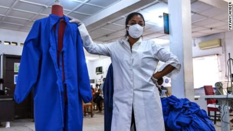 Fashion designer Folake Akindele Coker switched to producing PPE to keep her factory open.