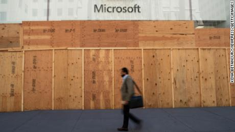 A Microsoft store is boarded up on June 08, 2020 in New York City. The city began the first phase of reopening after nearly three months of being shutdown due to the coronavirus (COVID-19) pandemic. Protests continue over the abuse of African Americans by the Police. (Photo by Kena Betancur/VIEWpress via Getty Images)