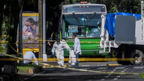 Experts work at the crime scene after Mexico City's Public Security Secretary Omar Garcia Harfuch was wounded in an attack in Mexico City on Friday, June 26, 2020