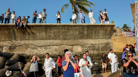 Members of Mumbai's Parsi Zoroastrian community pray at Parsi gate, Marine Drive, for Abangan, a day dedicated to the reverence of water as an element of creation on March 24, 2019.