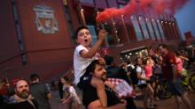 Fans celebrated Liverpool winning the title outside Anfield stadium.