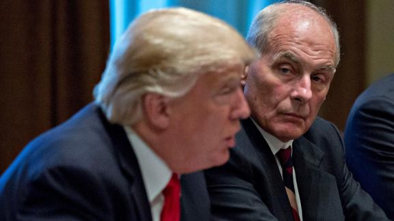 White House chief of staff John Kelly listens as U.S. President Donald Trump speaks at a briefing with senior military leaders in the Cabinet Room of the White House October 5, 2017 in Washington, D.C.