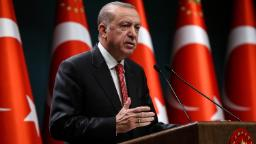Turkish President Recep Tayyip Erdogan gestures as he delivers a speech following a cabinet meeting, in Ankara, on June 9, 2020.