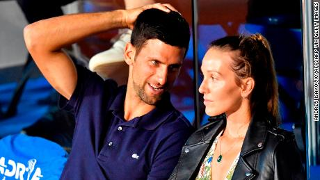 Serbian tennis player Novak Djokovic (L) talks to his wife Jelena during a match at the Adria Tour, Novak Djokovic's Balkans charity tennis tournament in Belgrade on June 14, 2020.