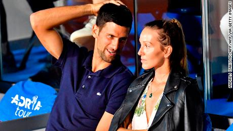 Serbian tennis player Novak Djokovic (L) talks to his wife Jelena during a match at the Adria Tour, Novak Djokovic's Balkans charity tennis tournament in Belgrade on June 14, 2020. - The ATP and WTA Tours have been suspended since March due to the COVID-19 pandemic and will not resume at least until the end of July 2020. (Photo by Andrej ISAKOVIC / AFP) (Photo by ANDREJ ISAKOVIC/AFP via Getty Images)