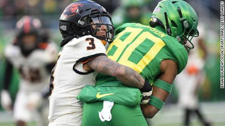Oregon Ducks WR Bryan Addison (80) is tackled by Oregon State Beavers DB Jaydon Grant (3) on November 30, 2019. The two teams used to refer to this rivalry game as the 'Civil War,' but no longer.