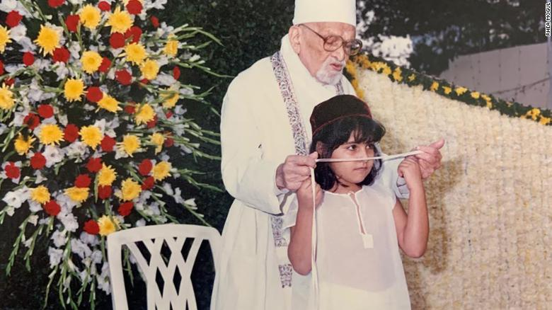 A child undertakes the Zoroastrian initiation  ceremony in Mumbai in 1999.