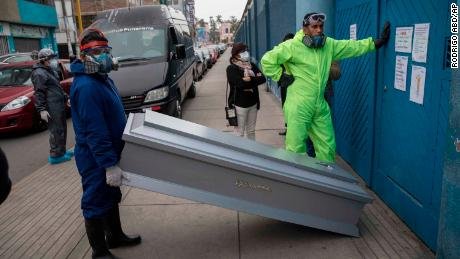 Coffins are brought to a funeral home in Santiago, the capital of Chile, June 19, 2020.
