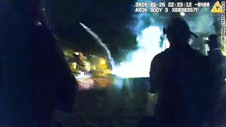 Virginia State Police body camera footage shows fireworks going off Friday night at the protest site in Richmond.