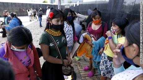 Embera-Chami indigenous people join a sit-in protest against the alleged rape of a young girl by seven soldiers, who have been arrested and are awaiting trial.