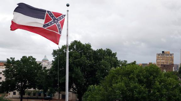 Image for Mississippi governor signs bill to retire flag with Confederate emblem