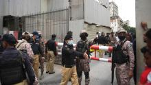 On June 29, 2020, security personnel gathered at the main entrance of the Pakistan Stock Exchange building in Karachi.