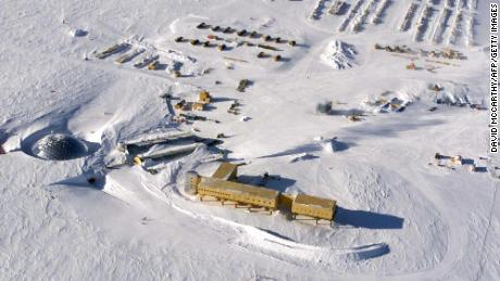 This handout photo dated 31 October 2002 shows an aerial view of the new elevated station (bottom-C) being built at the US Amundsen-Scott South Pole Station in Antarctica. The new station, scheduled to be completed in 2007, is elevated to allow snow to drift underneath and is capable of being jacked up higher as snow accumulates. The new base will replace previous bases already buried under snow, with the original 1957 base about 10 meters (36 feet) under and the current dome base (pictured far L) also becoming buried.   AFP PHOTO/USAF-NATIONAL SCIENCE FOUNDATION/HO (Photo credit should read DAVID MCCARTHY/AFP via Getty Images)
