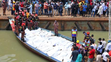 At least 32 people died after a ferry capsized and sank in the Bangladeshi capital Dhaka following a collision with another vessel, officials said.