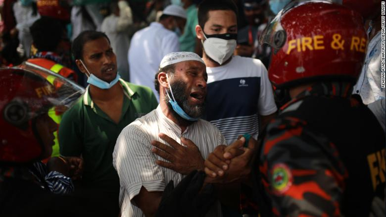 A relative of a victim reacts after rescuers recovered the bodies of victims.
