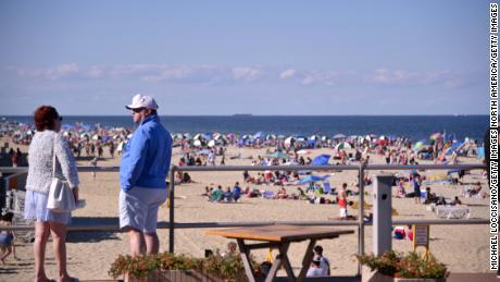 Crowds return to the boardwalk and beach at Pier Village on June 14, 2020 in Long Branch, New Jersey.