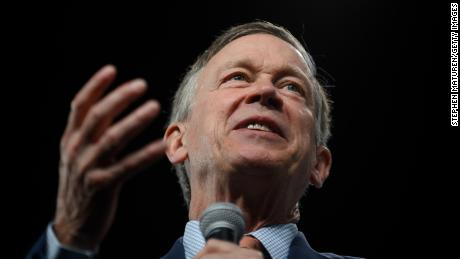 In this December 3, 2019, file photo, then-Democratic presidential candidate John Hickenlooper speaks during a forum on gun safety at the Iowa Events Center in Des Moines.