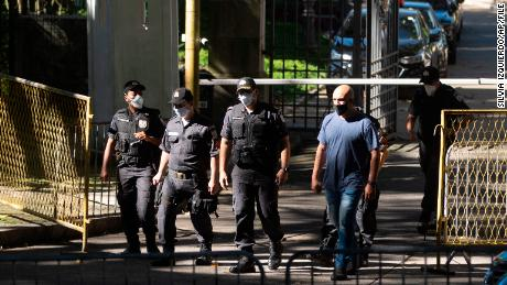 Military police walk outside the official residence of Rio de Janeiro Gov. Wilson Witzel on May 26 after a raid by Federal Police as part of an investigation into the alleged embezzlement of public resources.