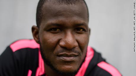 In this photo taken on March 7, 2017, West Indies cricketer Darren Sammy, who is playing with local team Hung Hom JD Jaguars at the 2017 DTC Hong Kong T20 Blitz cricket tournament, poses for AFP in Hong Kong. Foreign players have tentatively endorsed the return of international cricket to Pakistan after their whirlwind trip to Lahore for Sunday's heavily guarded Pakistan Super League final. / AFP PHOTO / Anthony WALLACE (Photo credit should read ANTHONY WALLACE/AFP via Getty Images)