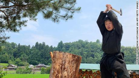 Genichi Mitsuhashi has become the first student ever to graduate from a Japanese university with a master's degree in ninja studies.
