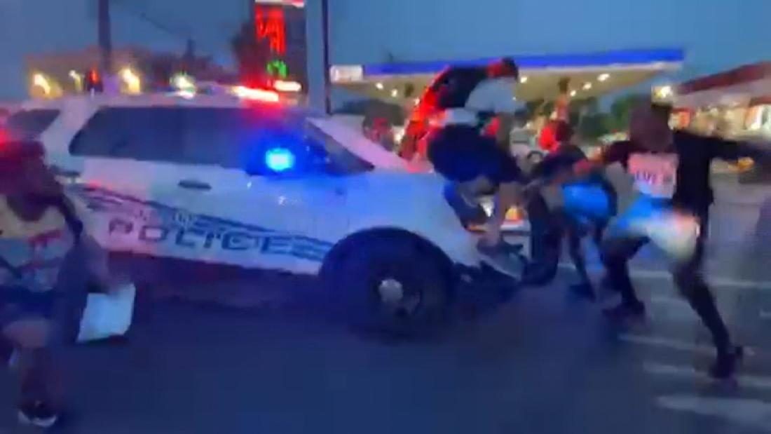 Video appears to show Detroit police car driving into protesters