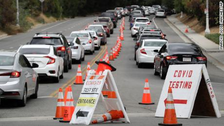 Motorists line up at a coronavirus testing site at Dodger Stadium Monday, June 29, 2020, in Los Angeles.