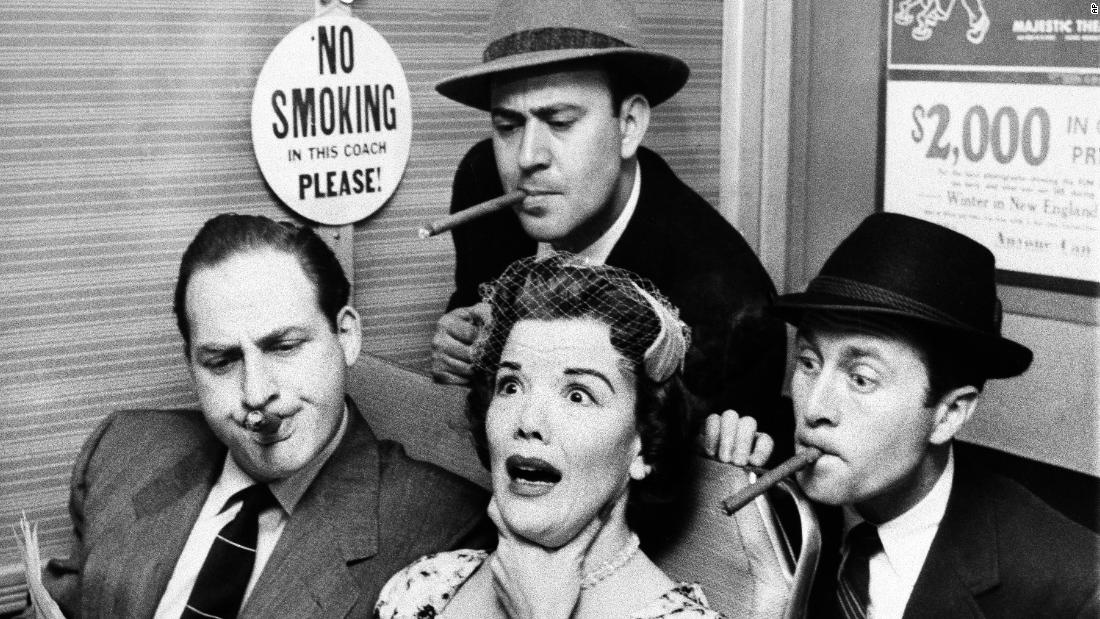 "Reiner and Caesar also starred in ""Caesar's Hour,"" from 1954-1957. In this scene from April 1955, Reiner, top center, Caesar, left, and Howard Morris, right, smoke while trying to read Nanette Fabray's newspaper. Reiner won two Emmy Awards for his performance on the show."