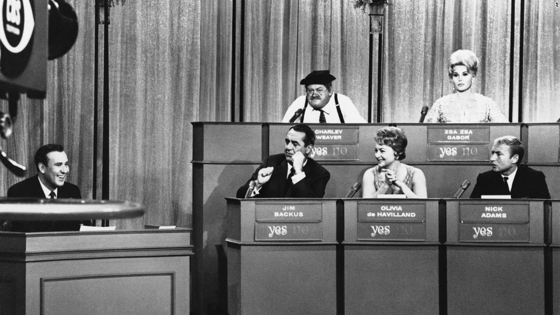 "Reiner, left, hosts ""The Celebrity Game"" in March 1965."