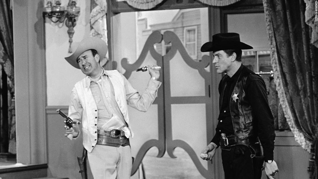"Pictured here -- during a scene from ""The Gunslinger"" episode on ""The Dick Van Dyke Show"" -- are Reiner, left, and Dick Van Dyke. Reiner is in the role of Alan ""Big Bad"" Brady, while Van Dyke plays a small-town sheriff named Rob Petrie. Reiner had a hand in writing many of the show's scripts."