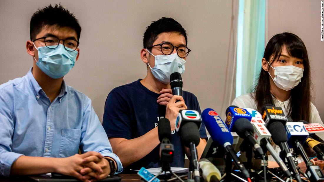 From left, Joshua Wong, Nathan Law and Agnes Chow — members of the pro-democracy political group Demosisto — hold a news conference on May 30. A month later, Demosisto and several other political and activist groups formally disbanded, fearing they could be targeted under the new law.