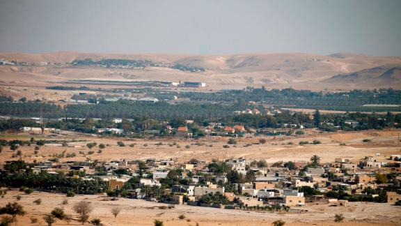 A general view shows the Jordan Valley village of Fasayil (foreground) with the Israeli settlement of Tomer (background), in the occupied West Bank on June 30, 2020. - Israel intends to annex West Bank settlements and the Jordan Valley, as proposed by US President Donald Trump, with initial steps slated to begin from July 1. (Photo by JAAFAR ASHTIYEH / AFP) (Photo by JAAFAR ASHTIYEH/AFP via Getty Images)