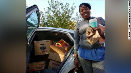 Chrishawndra Matthews getting ready to deliver a car full of books.