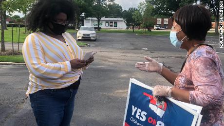 Supporters of the Medicaid expansion meet with voters in Oklahoma.