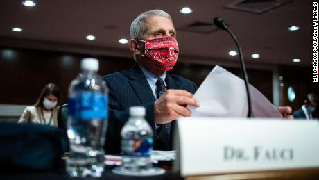 WASHINGTON, DC - JUNE 30: Dr. Anthony Fauci, director of the National Institute of Allergy and Infectious Diseases, wears a Washington Nationals protective mask while arriving to a Senate Health, Education, Labor and Pensions Committee hearing on June 30, 2020 in Washington, DC. Top federal health officials are expected to discuss efforts to get back to work and school during the coronavirus pandemic. (Photo by Al Drago - Pool/Getty Images)