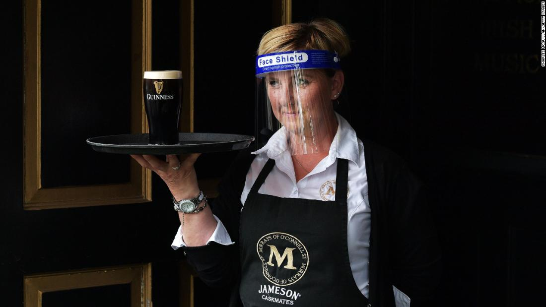 DUBLIN, IRELAND - JUNE 29: A barmaid waits for a pint of Guinness to settle before serving a customer at Murrays pub on Grafton street on June 29, 2020 in Dublin, Ireland. Restaurants, pubs, cafes and hairdressers were among the businesses that can open across Ireland today provided they can observe social distancing rules to reduce transmission of the coronavirus. (Photo by Charles McQuillan/Getty Images)