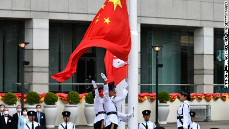 The flags of China (front) and Hong Kong are released during a flag-raising ceremony to mark early-morning China National Day celebrations in Hong Kong on July 1, 2020.