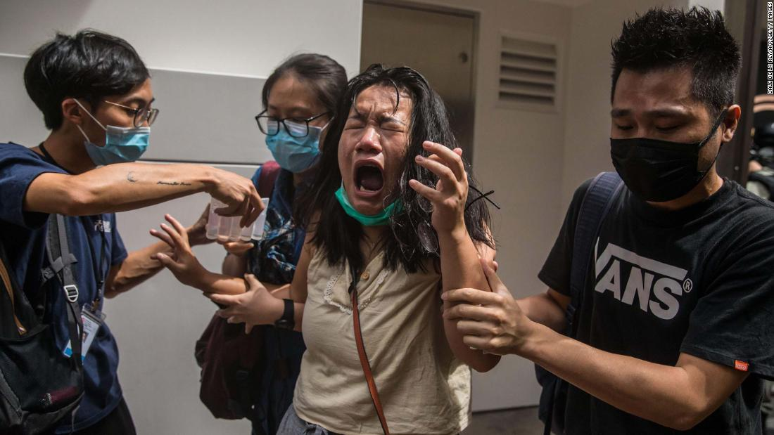 A woman reacts to pepper spray as police were clearing protesters in Hong Kong on Wednesday, July 1.