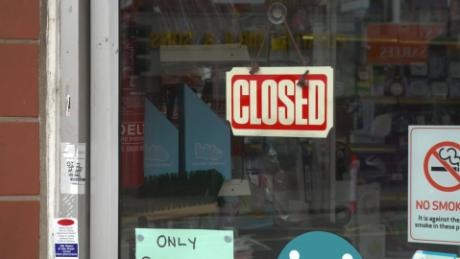 A closed sign in the window of a business in the city, which faced a fresh surge in cases as the UK reopened.