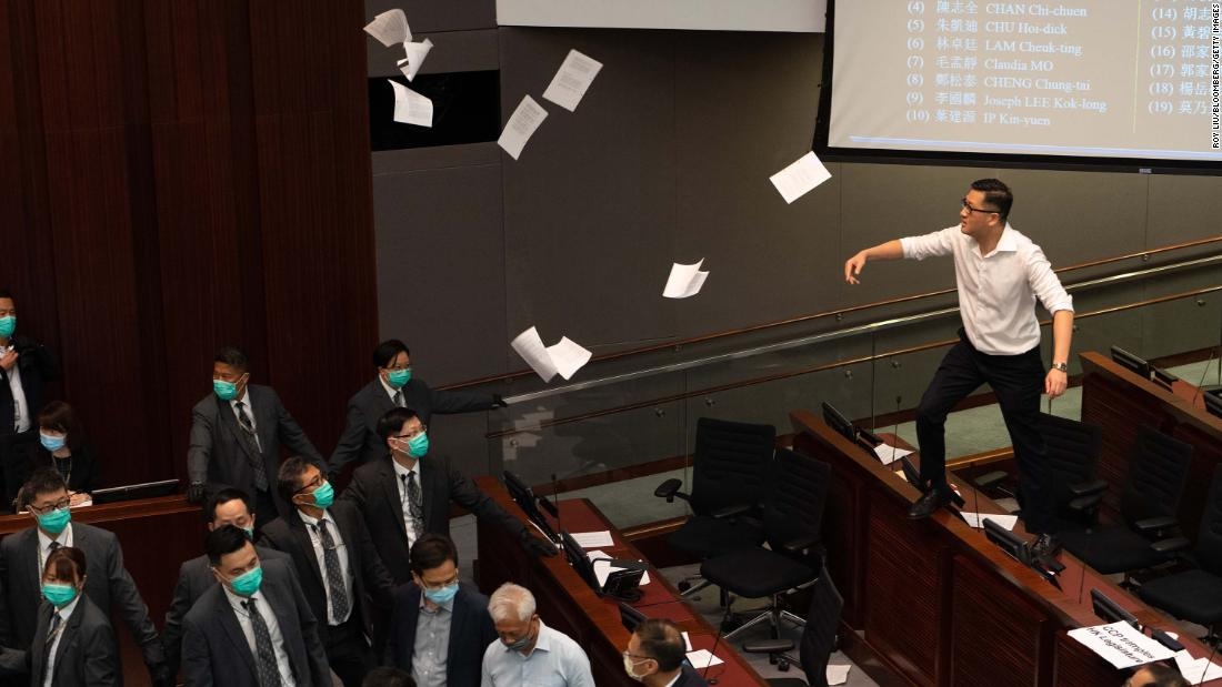 Lam Cheuk-ting, a pro-democracy lawmaker, tosses papers into the air in protest on May 18.