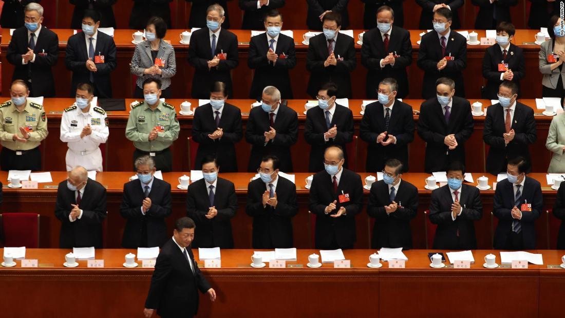 Delegates applaud as Chinese President Xi Jinping arrives for the opening session of China's National People's Congress on May 22.