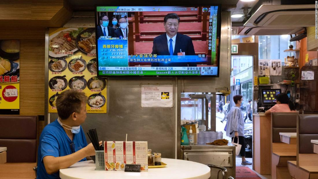 A man at a diner watches Chinese President Xi Jinping on May 28 as Chinese lawmakers approved a proposal for the new security law.