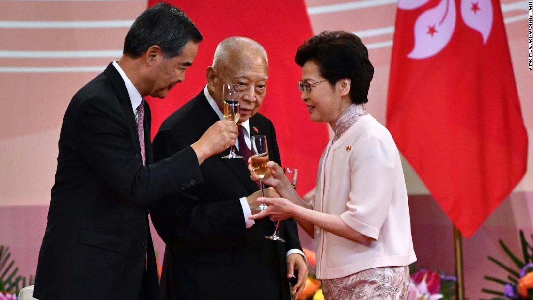 Hong Kong Chief Executive Carrie Lam makes a toast with former chief executives Tung Chee-hwa, center, and Leung Chun-ying following a flag-raising ceremony on July 1. July 1 is the 23rd anniversary of Hong Kong's handover from British rule to China.