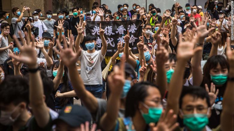Hong Kong protest leader flees as government warns calls for 'revolution' are now illegal