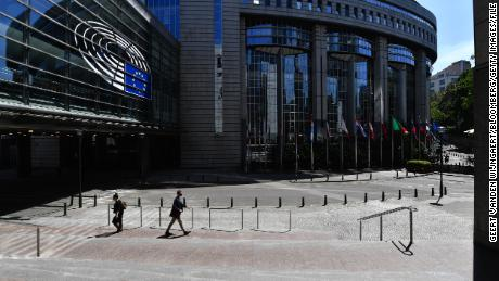 Pedestrians pass the European Parliament's Paul-Henri Spaak building in Brussels, Belgium, on Wednesday, May 27, 2020.